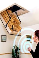 Electric wood hatch and loft ladder