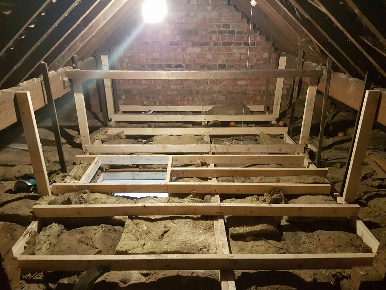 Suspended loft storage floor sub-frame